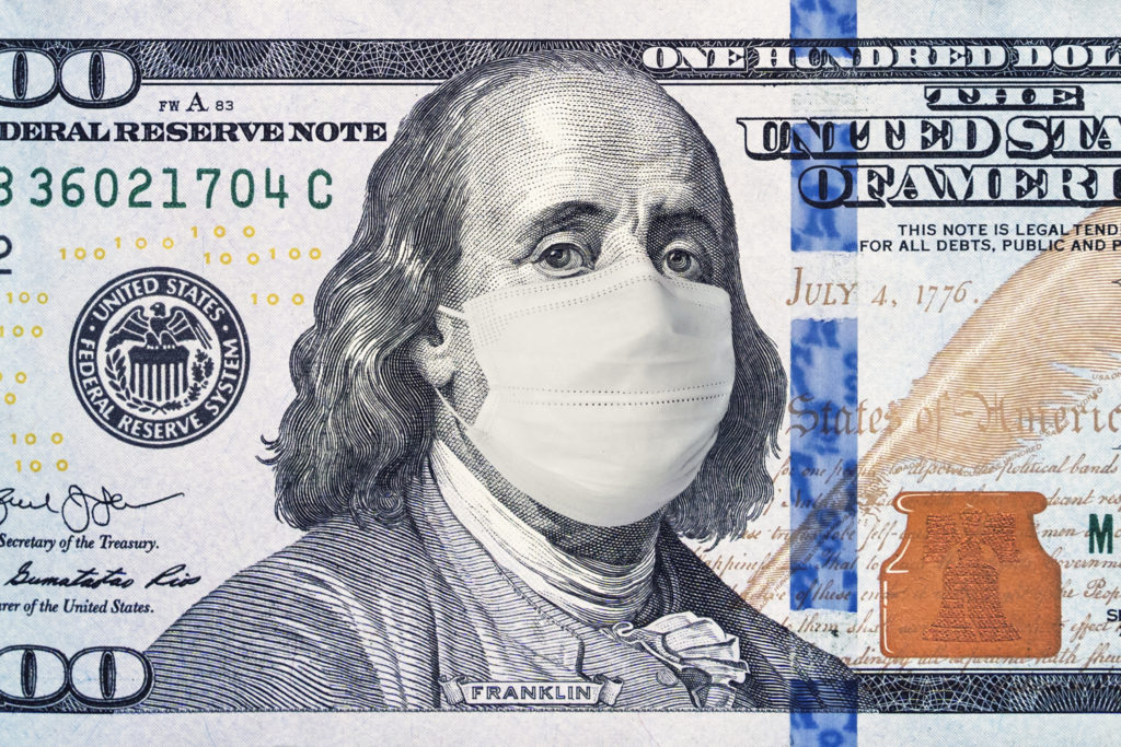 American President with a face mask against CoV infection. 100 dollar banknote. Coronavirus in United States. Concept quarantine and recession. Global economy hit by corona virus outbreak and pandemic