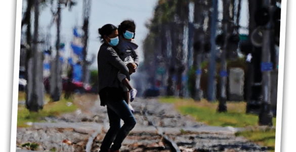 Mother and child crossing the border.